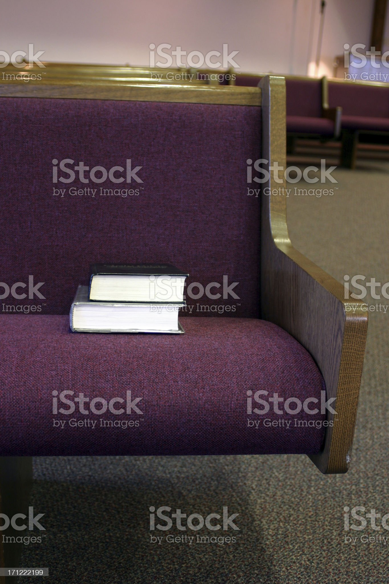 Church pew with hymnal and bible royalty-free stock photo