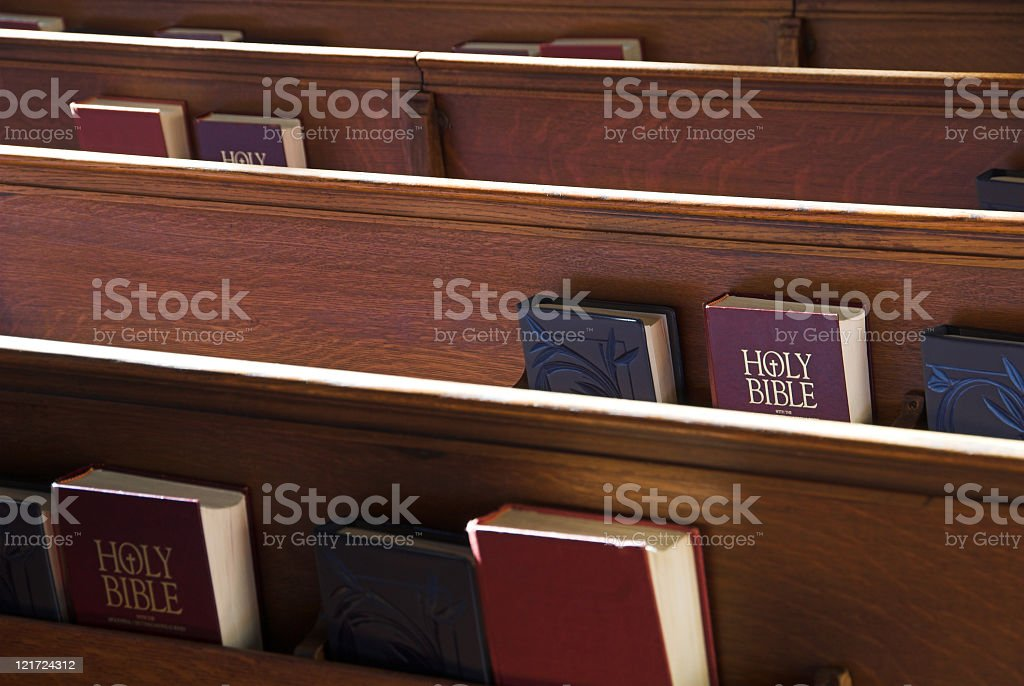 Church pews with bibles stored in the back royalty-free stock photo