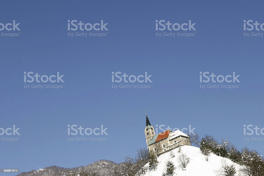 Church pointing in a blue sky stock photo