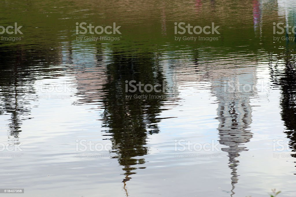 Church reflected in water stock photo