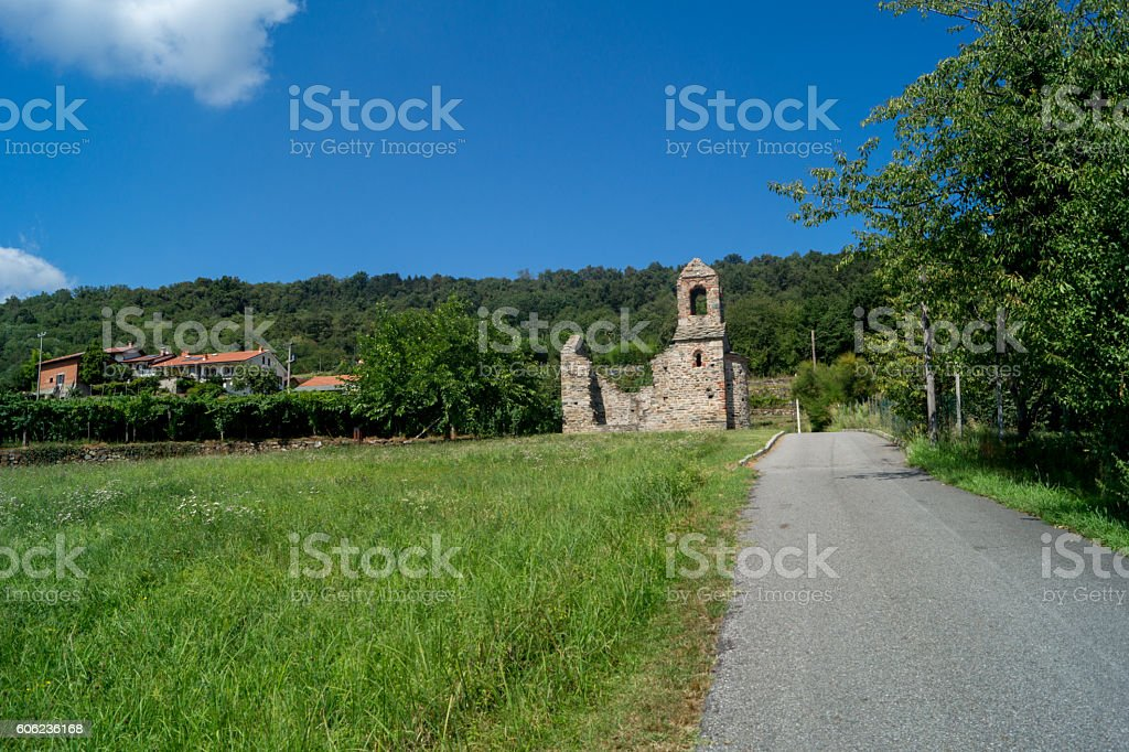 Church ruined, ruined bell tower in the woods stock photo