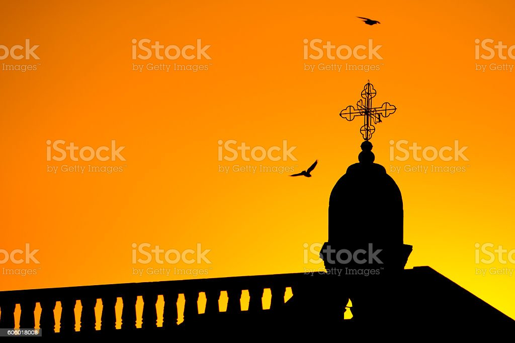 church silhouette and pigeons stock photo