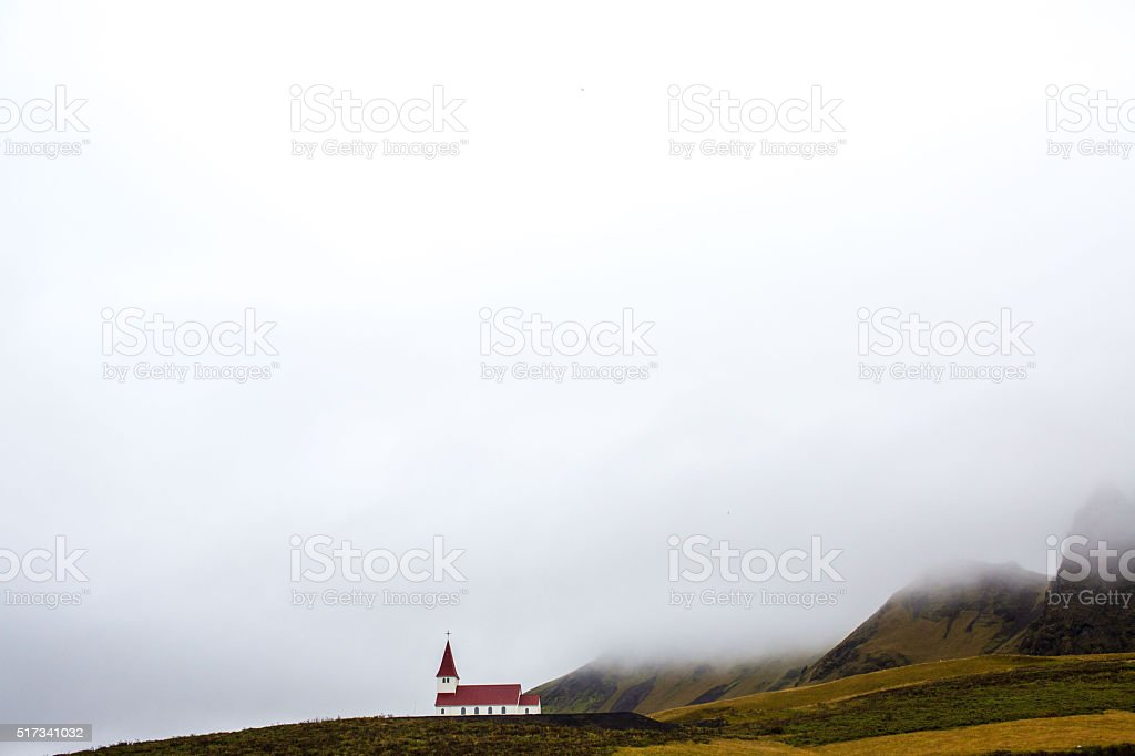 Church sits in front of Icelandic mountains stock photo
