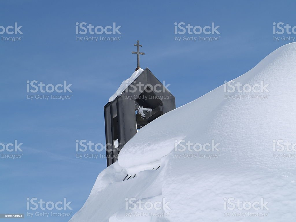 Church spire with snow stock photo