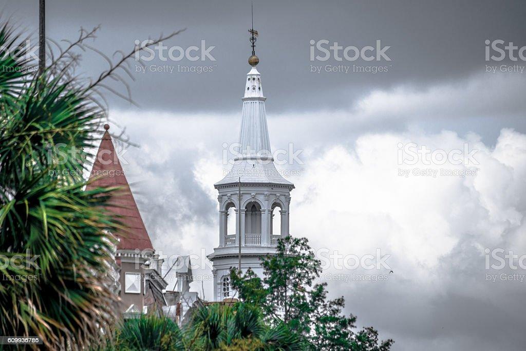 Church steeple against cloudy sky stock photo