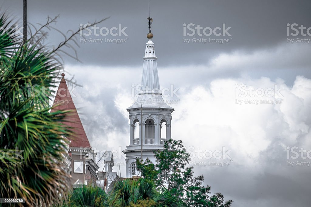 Church steeple against cloudy sky stock photo