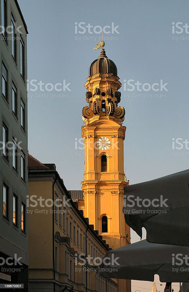 Church steeple at sunset in Munich, Germany royalty-free stock photo