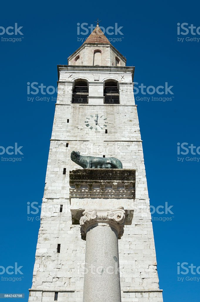 Church steeple in front of capitoline wolf column stock photo