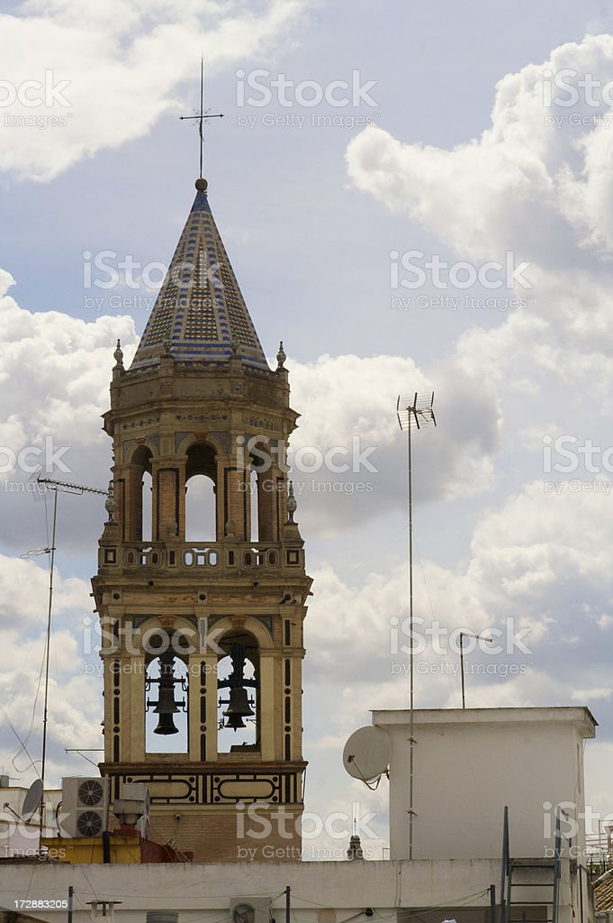 Church Steeple Rises in Sky Above Seville royalty-free stock photo