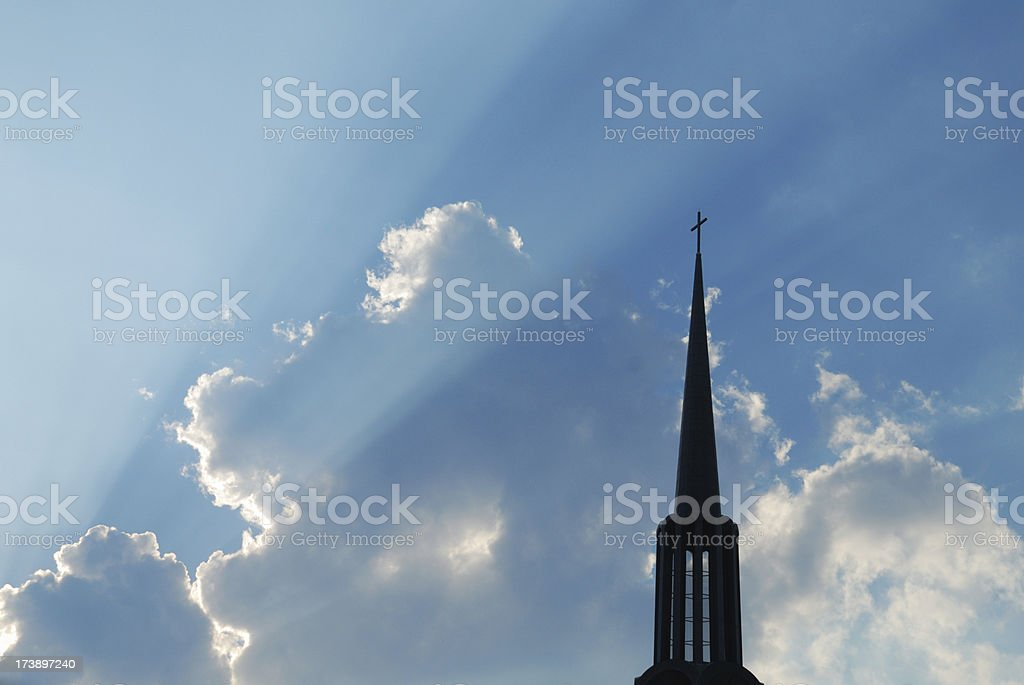 Church steeple silhouette in sunrays royalty-free stock photo