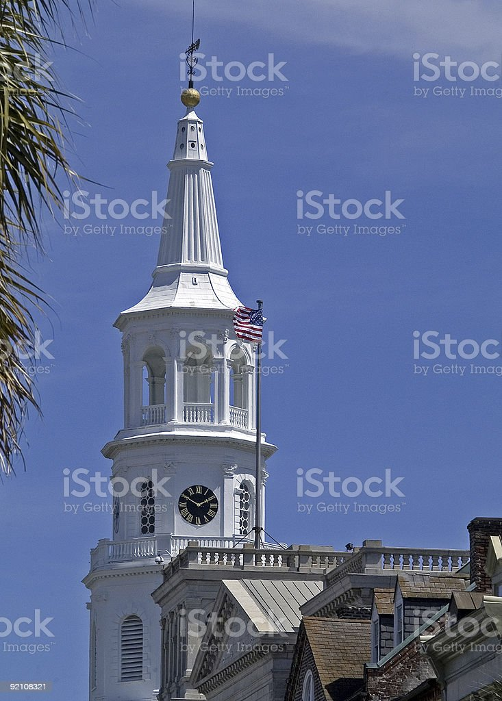 church steeple with American Flag royalty-free stock photo