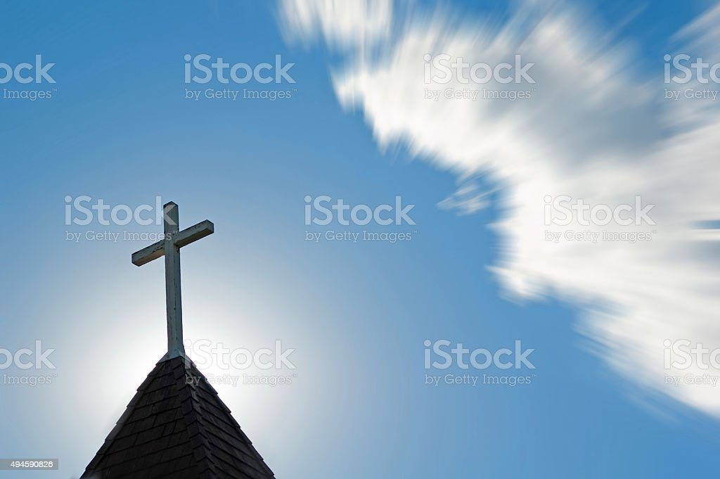 Church steeple with cross at sunset  Copy space and zoom stock photo