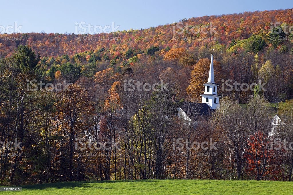 Church surrounded by Autumn foliage, Vermont royalty-free stock photo
