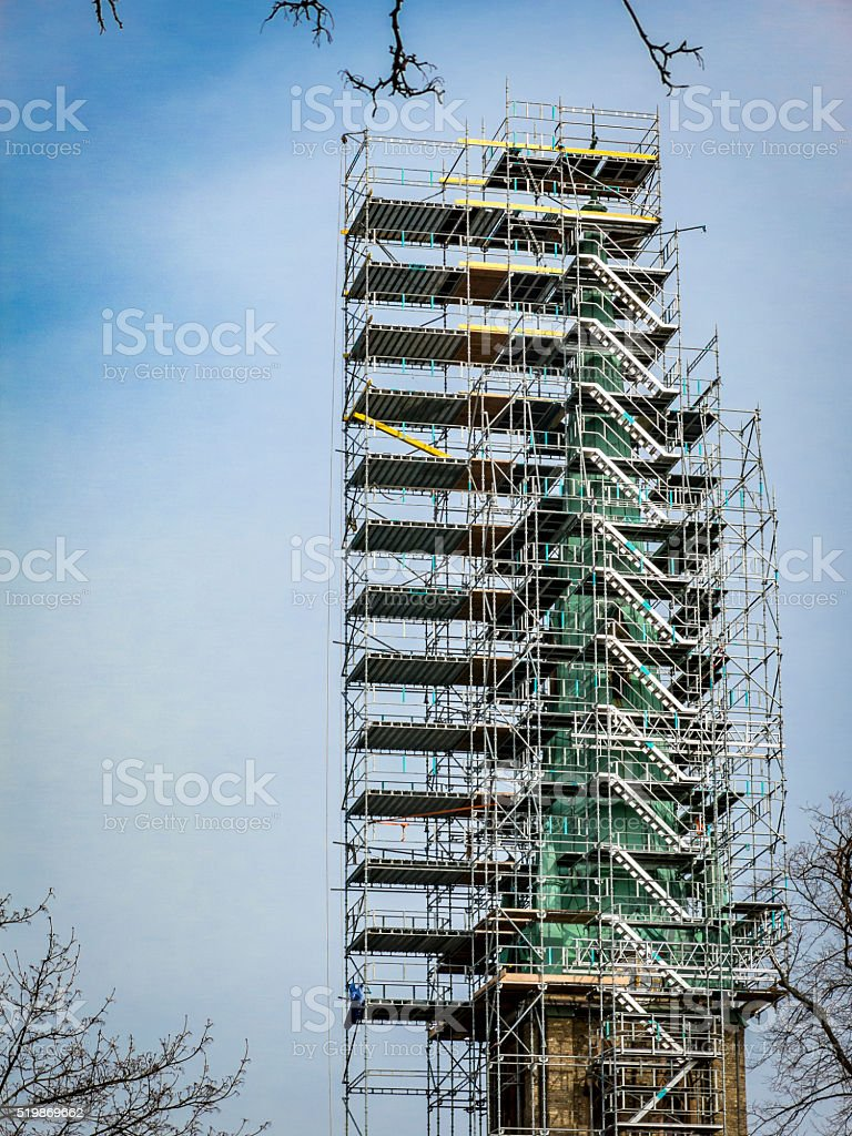 Church surrounded with unique scaffolding stock photo