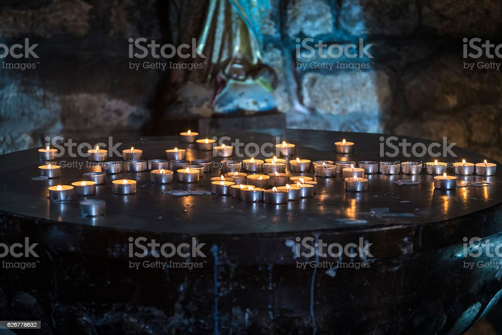 Church tea-lights, Krk Cathedral, Croatia stock photo