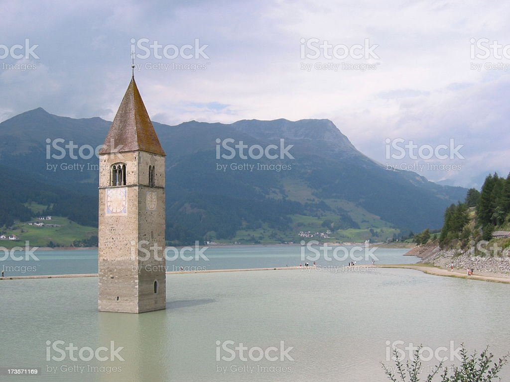 Church tower lost in a lake royalty-free stock photo