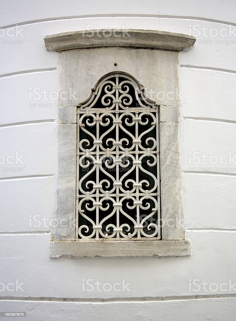 Church window with decorative ironwork stock photo