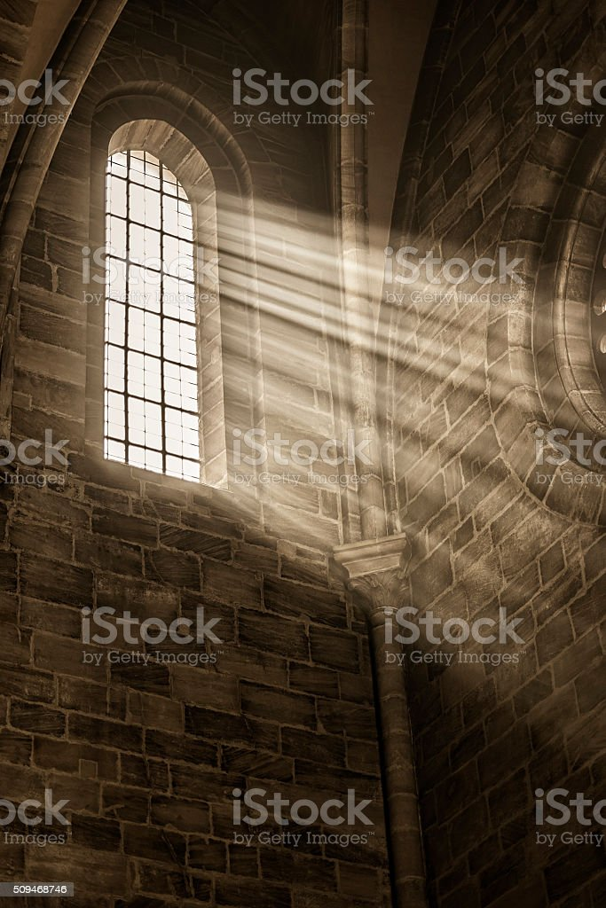 church window with sunbeams stock photo