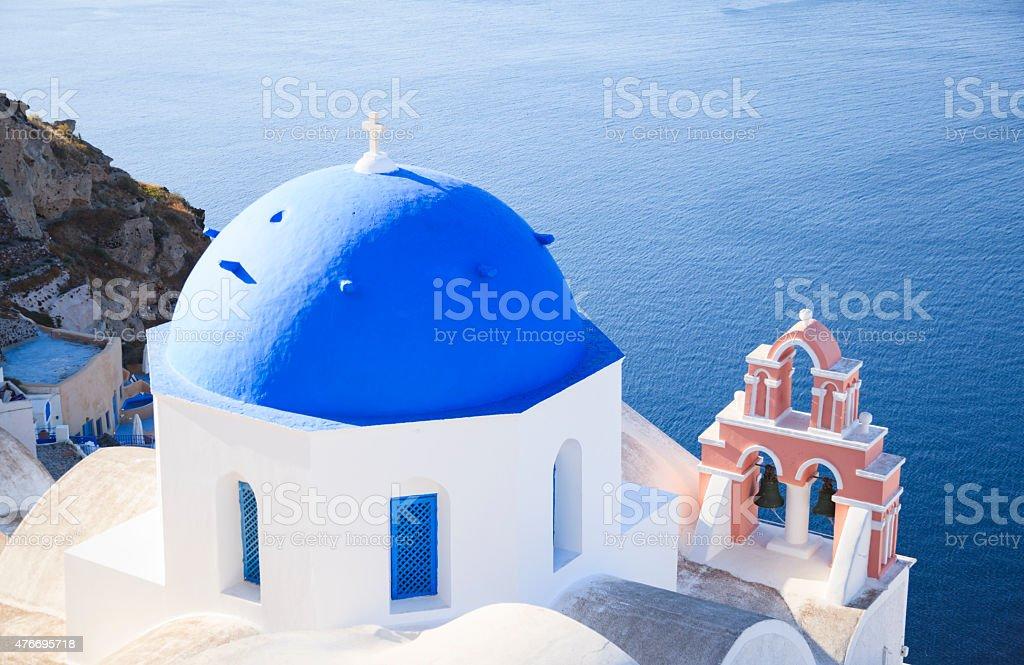 Church with blue dome in Oia Village on Santorini (Greece) stock photo