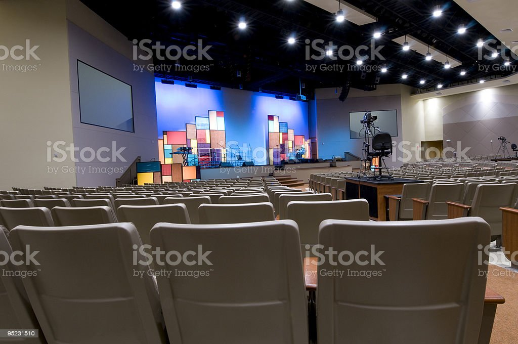 Church with Blue Lit Stage stock photo