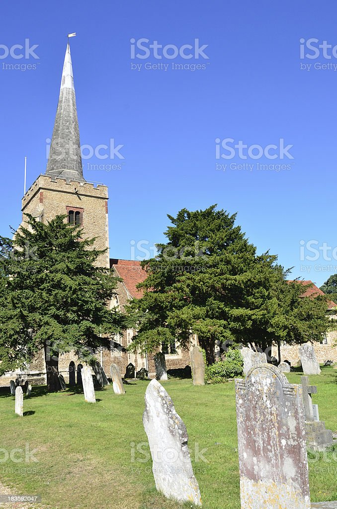 Church with Gravestones in Foreground royalty-free stock photo
