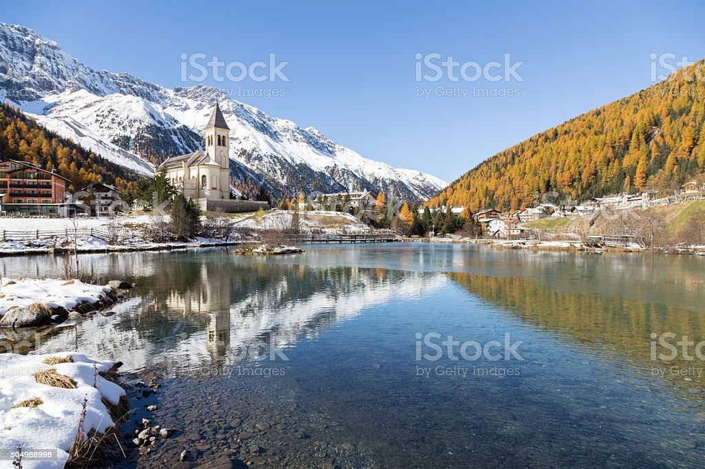 Church with lake in the alps (Sulden/Solda/Italy) stock photo