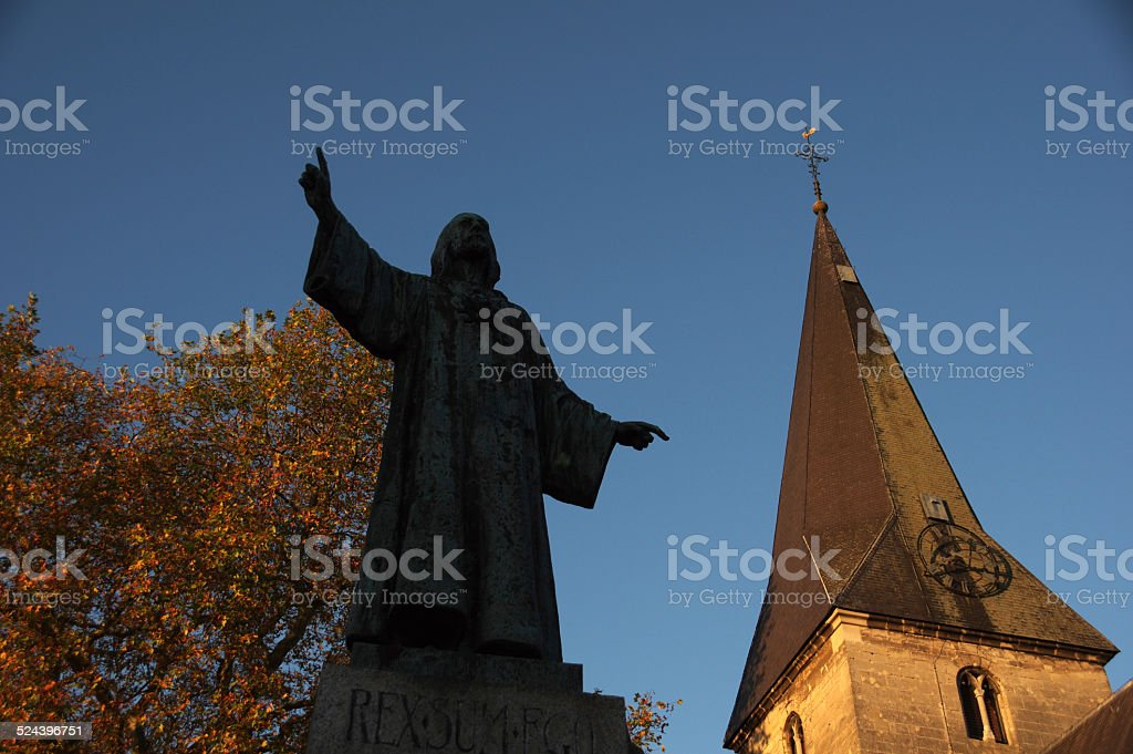Church with monument in the vilagecenter stock photo