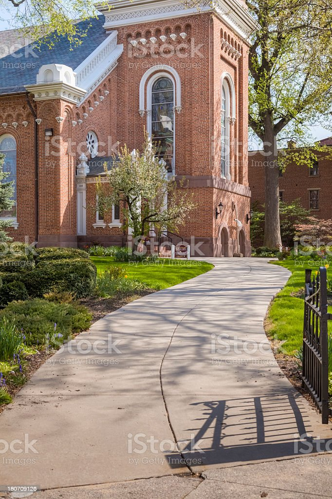 Church Yard Curving Pathway in the Sunlight royalty-free stock photo