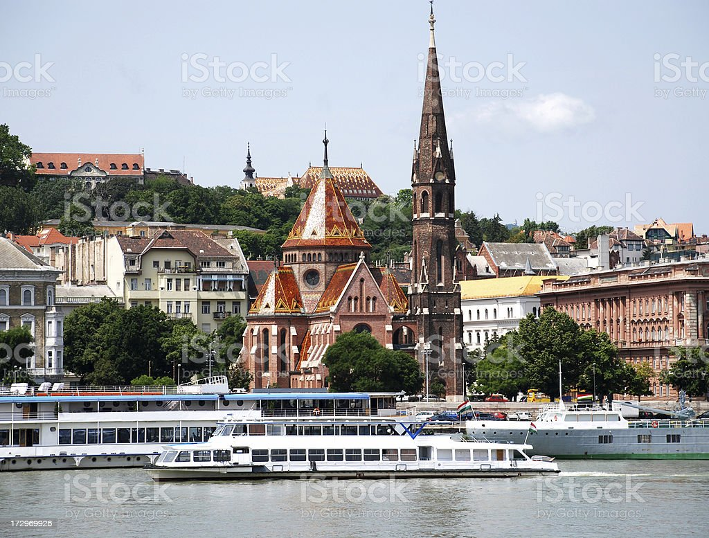 churches and boats at Budapest city stock photo