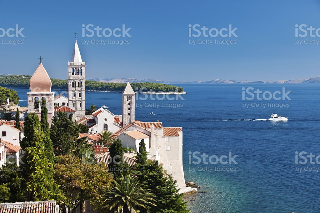 Churches dominate the skyline of Rab stock photo