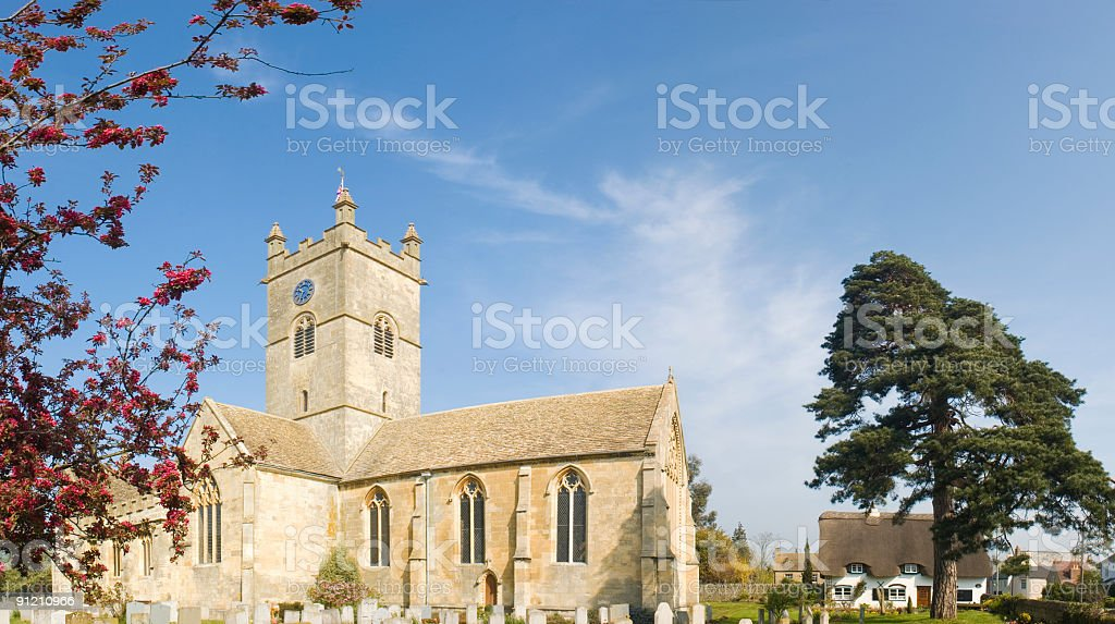 Churchyard and cottage royalty-free stock photo