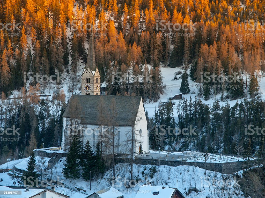 Churh in Scuol after sunset stock photo