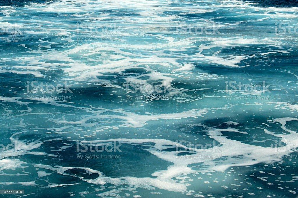 Churning water behind a cruise ship stock photo