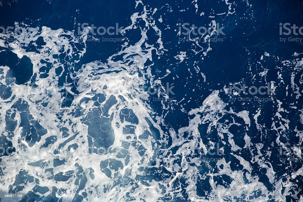 Churning water in the sea stock photo