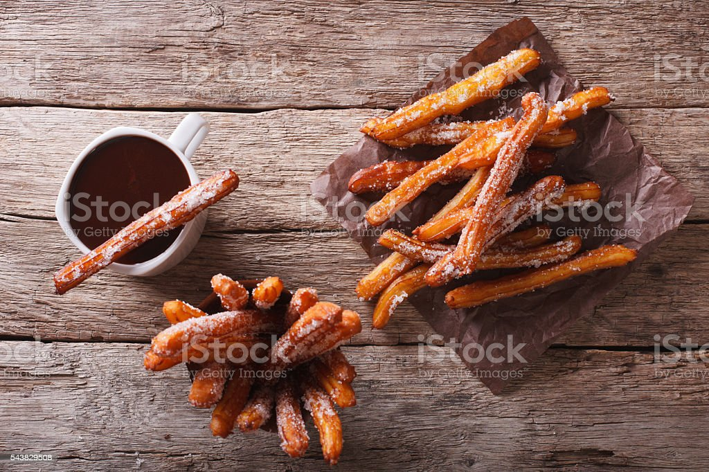 churros and hot chocolate on the table. horizontal top view stock photo