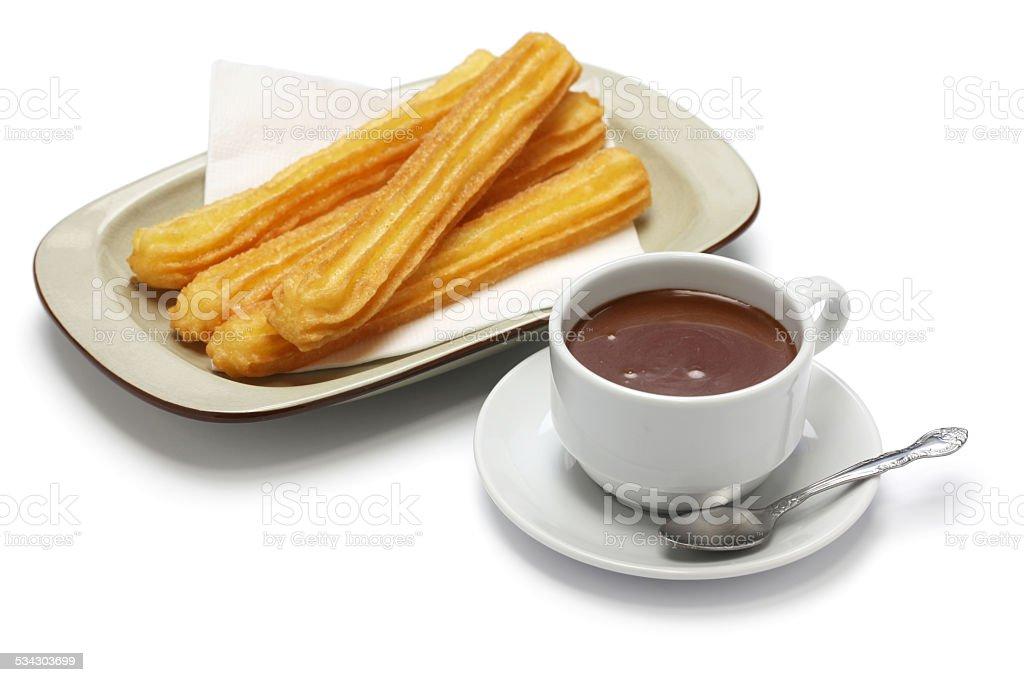 churros and hot chocolate on white background stock photo