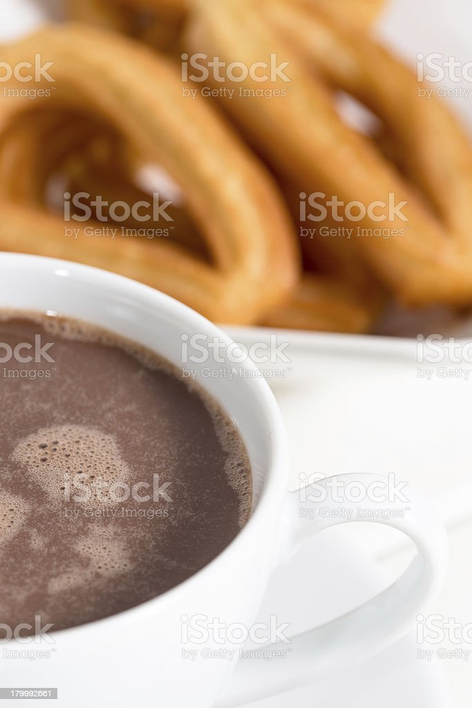 Churros with chocolate royalty-free stock photo