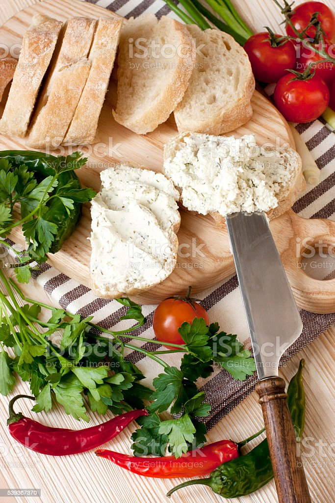 Ciabatta bread on cutting board with knife stock photo