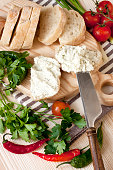 Ciabatta bread on cutting board with knife