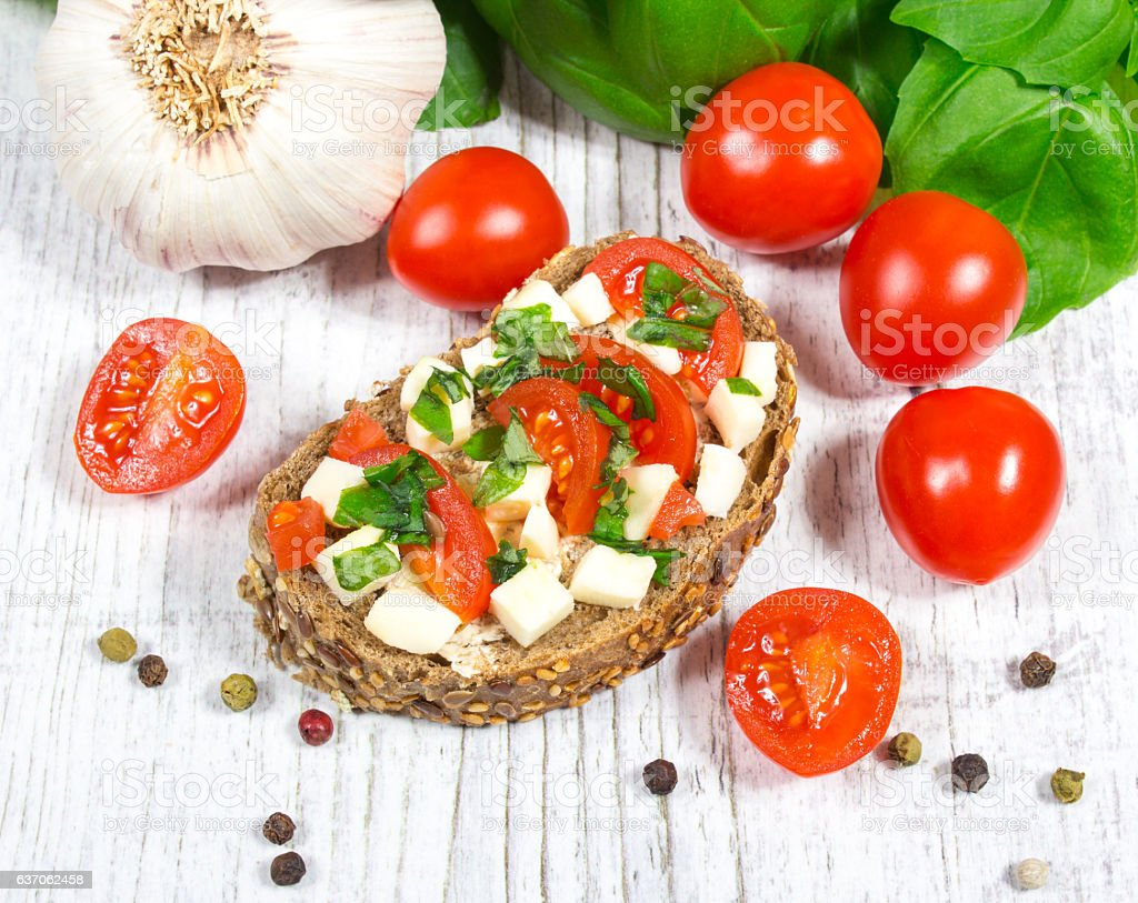 Ciabatta bread with tomatoes, mozzarella and basil. stock photo