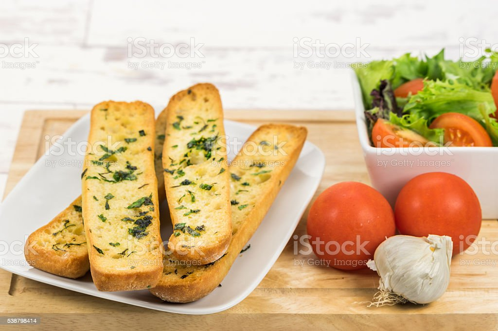 Ciabatta garlic bread with a salad stock photo