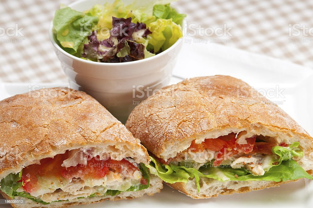 ciabatta panini sandwich with chicken and tomato stock photo
