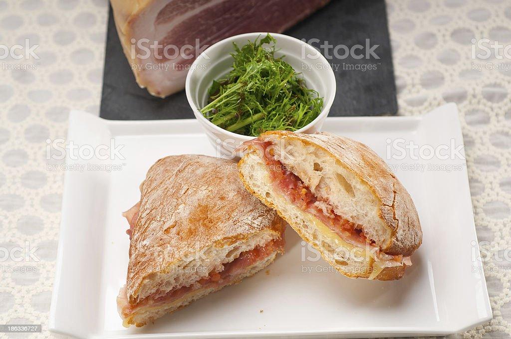 ciabatta panini sandwich with parma ham and tomato royalty-free stock photo