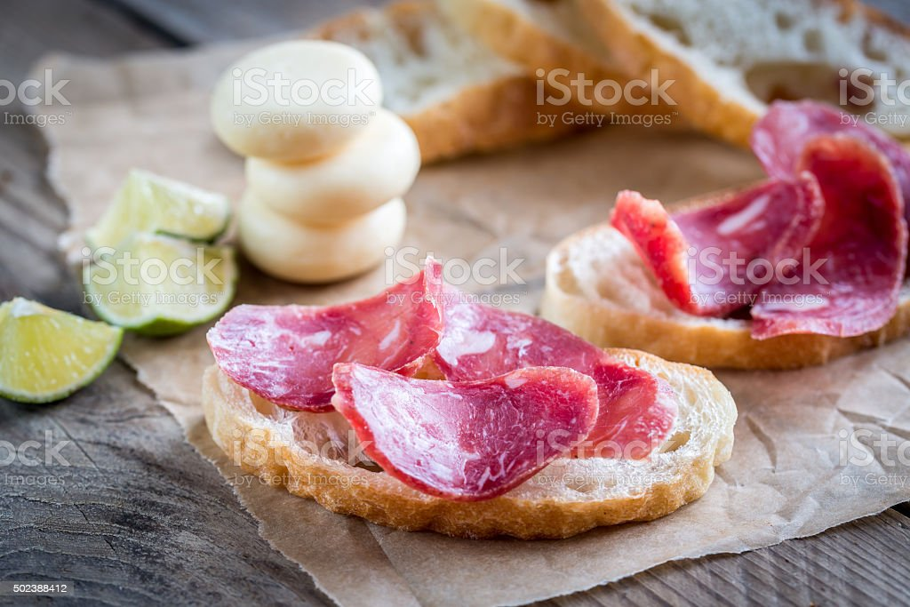 Ciabatta sandwiches with fuet and mini cheese stock photo