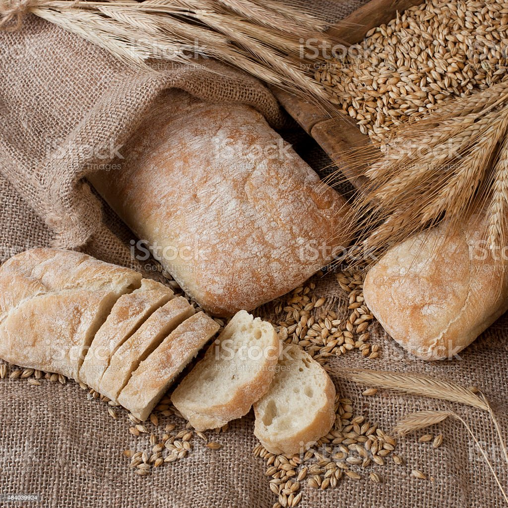 Ciabatta with baguette on burlap stock photo