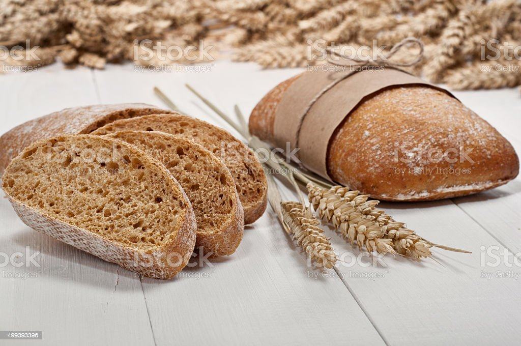 ciabatta with ears of wheat stock photo