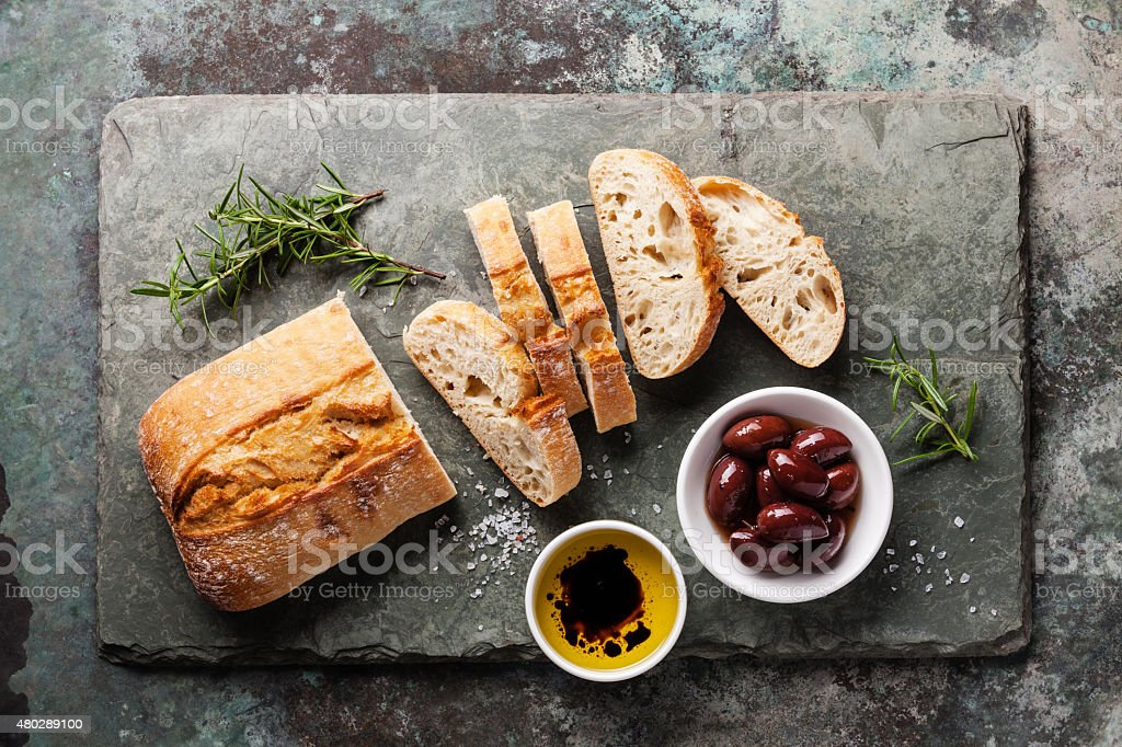 Ciabatta with olive oil and olives stock photo