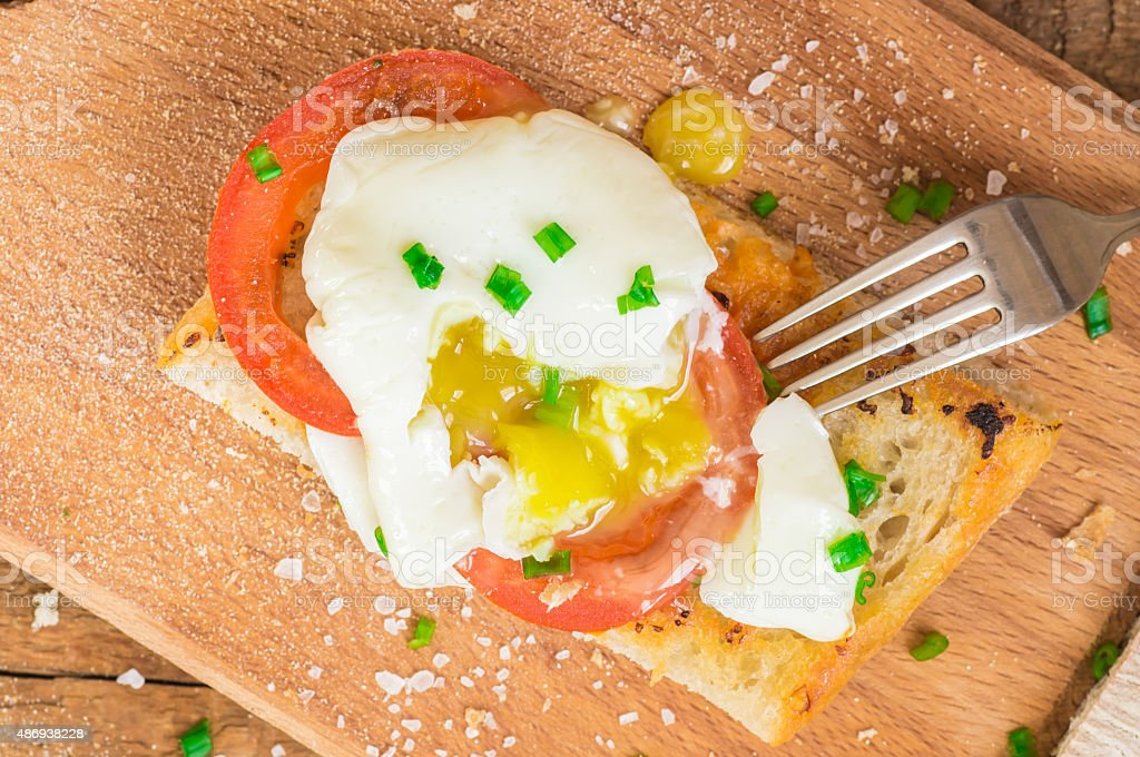 Ciabatta with poached egg yolk stemming stock photo
