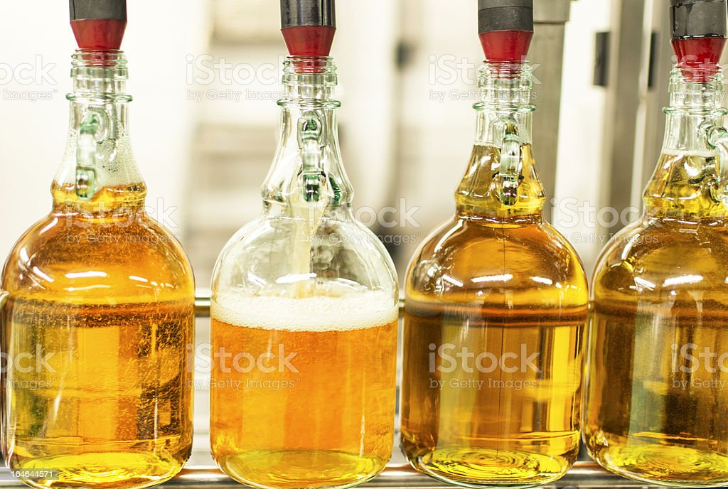 Cider being bottled stock photo