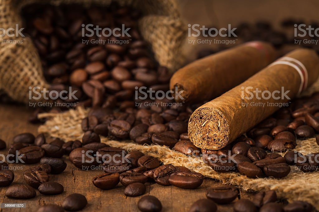 cigar and coffee bean in small sack stock photo